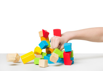 Hand beating house made of color wooden blocks