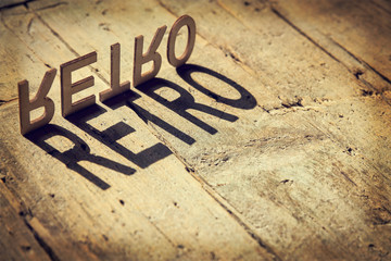 Wooden letters build the word retro