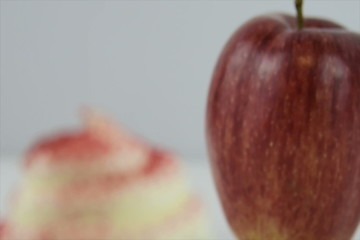 Starts focused on a red velvet cupcake, then a red apple