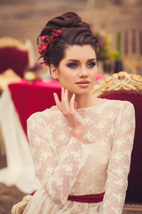 Young beautiful brunette woman in elegant lace dress