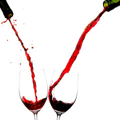 Pouring wine into two glasses