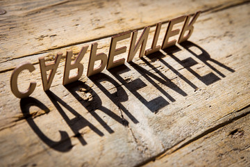 Wooden letters build the word carpenter