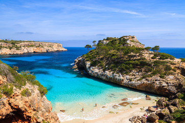 Couple of people on Cala des Moro beach, Majorca island, Spain