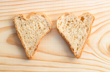 Couple of slices of bread in the form of hearts