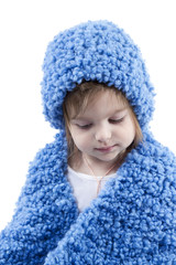 Little girl in blue hat and scarf