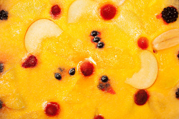 Cake with fruit flooded to jelly