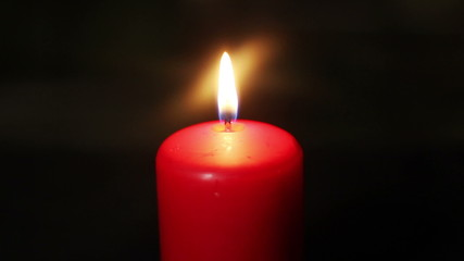 One candle burning brightly in the dark. HD 1080p