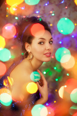 Young woman in night clubs lights. Luxury nightclub lifestyle. F