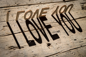 Wooden letters build the word i love you