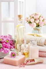 Spa set: bottle of essential oil, liquid soap, scoop of raspberr