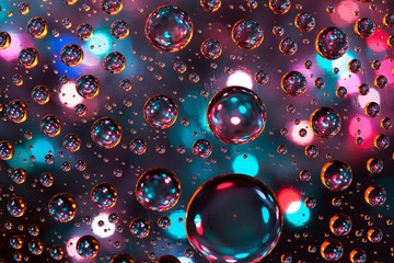 Abstract background texture drops of water and art light on glas