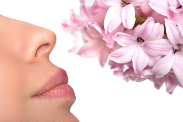 Close-up nose and a flower. Allergy to pollen of flowers. asthma
