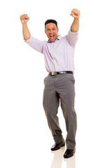 mid age man celebrating success