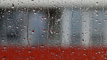Heavy rain on window glass