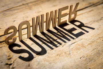Wooden letters build the word summer