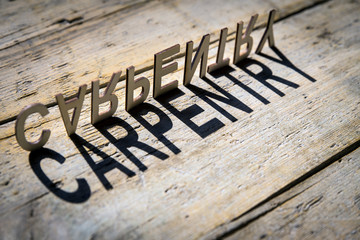 Wooden letters build the word carpentry
