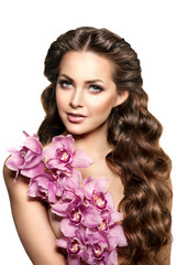Beauty young woman, luxury long curly hair with orchid flower. H