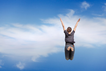girl jumping on the blue sky