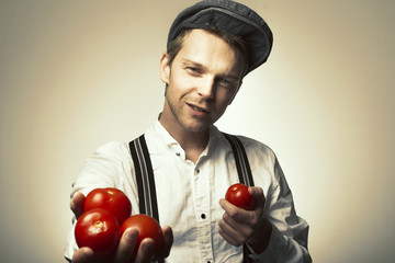 Farmer holding his tomatoes