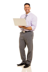 middle aged corporate worker holding laptop