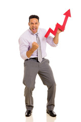 mid age businessman holding stock arrow