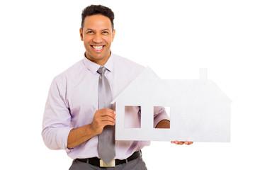 man showing house symbol