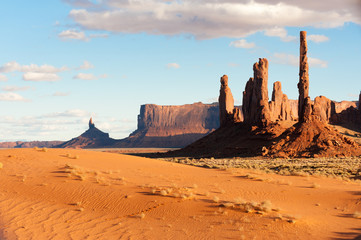 Totem pole rocks and sand dunes in Monument valley tribal park