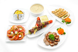 Set of international dishes arranged for catering, studio shot poster
