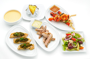 Set of international dishes arranged for catering, studio shot