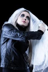 Portrait of a women in black with a veil in tears
