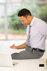 middle aged businessman reading report