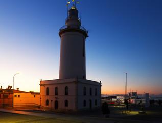 Beacon at Malaga in sunset
