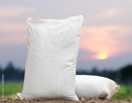 Fertilizer bag over sunrise - 80825892