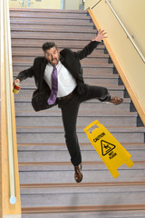 Businessman Falling on Stais