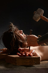 Jesus Being Nailed to the Cross