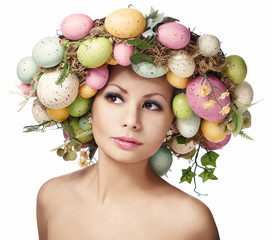 Easter Woman. Portrait of Beautiful Model with Colorful Eggs.