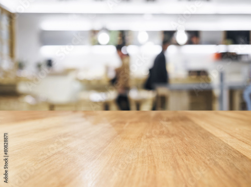 Fotobehang Industrial geb. Table top with People and blurred kitchen background