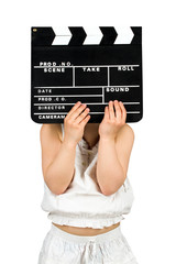 Kid holding clapper board