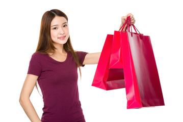 Shopping woman happy smiling holding shopping bag
