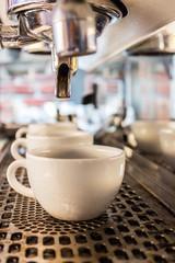 Coffee machine making espresso .