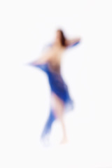 Out of Focus Image of a Woman with Blue Cloth