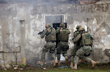 Swat team enters the room after explosion