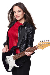 Sexy girl with electric guitar against white background