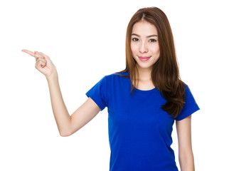 Asian woman pointing to empty space