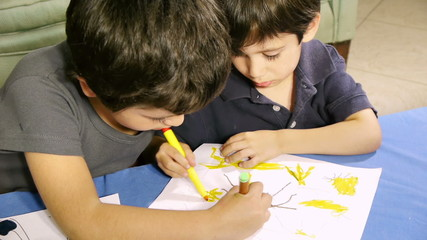 Boys Coloring Same Drawing