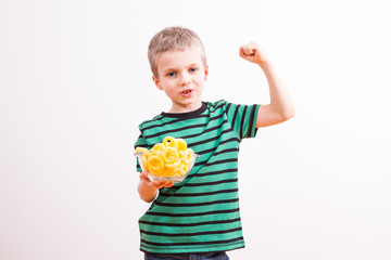 Young boy with a bowl of chips