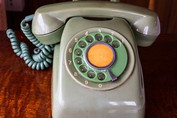 .Retro pastel telephone on wooden table