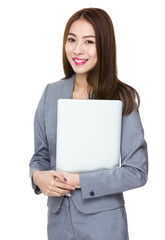 Young asian businesswoman hold with notebook computer