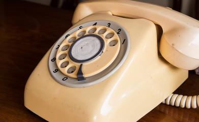 Retro pastel telephone on wooden table