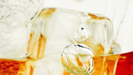 close-up of whiskey in glass with ice used for background